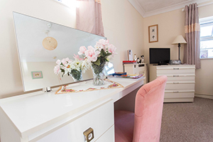 A stylish bedroom at Oak Mount Care Home